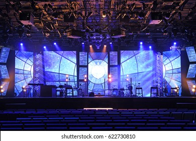 Concert stage with blue and orange lights before performance