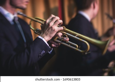 Concert view of a male trumpeter,  professional trumpet player with vocalist and musical during jazz band performing