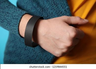 Concert wristband mockup, black hospital bracelet design. Arm adhesive, carpus paper accessory.