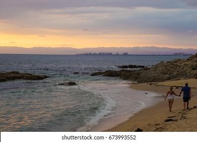 Conchas chinas beach in puerto vallarta jalisco mexico at sunset