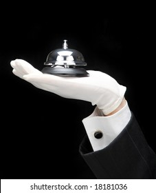 Concierge: His outstretched hand and arm holding a service bell.