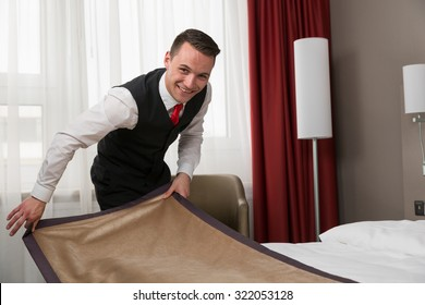 Concierge making the beds in a hotel room