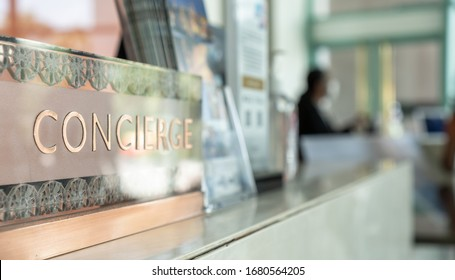 Concierge service counter of hotel, restaurant or apartment's front desk in luxury reception hall in Thailand with staff working for serving tourist guest or check-in customers