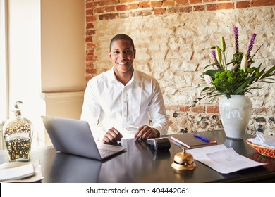 Concierge working at the check in desk of a boutique hotel