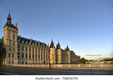 Conciergerie building located along of the Seine river and the center of Paris under a early sunrise lights. It was successively King's palace the prison and justice hall in french history.