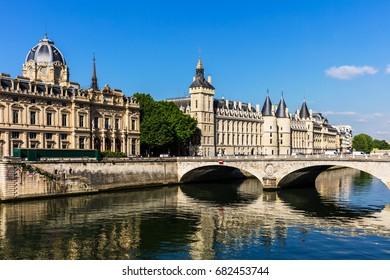 Conciergerie Castle and Bridge of Change (Pont au Change) over river Seine. Castle Conciergerie is a former prison, located on the Cite Island and today it is a part of Palais de Justice. Paris France