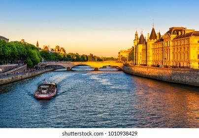 Conciergerie, Pont au Change is a bridge over the Seine River in Paris, France. Architecture and landmarks of Paris. Postcard of Paris