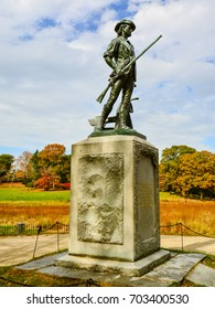 Concord, MA - Oct. 21, 2014: Minuteman Statue by the Old North Bridge. The statue depicts a farmer becoming a soldier to fight in the Revolutionary War.