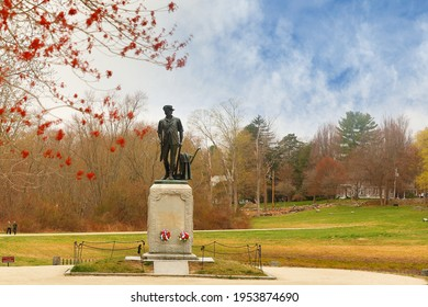 Concord, Massachusetts - April 11, 2021: The Minute Man statue and North Bridge  at Minute Man National Historic Park in early spring, Concord Massachusetts.
