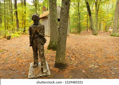Concord, Massachusetts - October 12, 2019: The  sculpture of Henry Thoreaus and his wooden house by the shores of Walden Pond. Walden Pond is a lake in Concord, Massachusetts in the United States