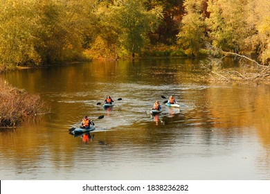 Concord, Massachusetts - October 18, 2020: Tourists kayaking on the Concord River at Minute Man National Historic Park with fall foliage as background, Concord Massachusetts.