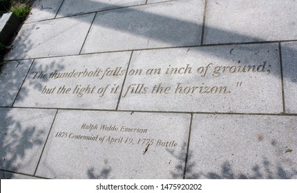 Concord, Massachusetts, United States - August 16, 2018: Closeup of a quote etched in stone/walking path by Ralph Waldo Emerson regarding the 100th anniversary of the battle of Lexington and Concord