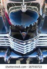 CONCORD, NC -- APRIL 05, 2014:  The front hood of a 1947 Cadillac reflects its surroundings while on display at the Charlotte AutoFair classic car show held at Charlotte Motor Speedway.