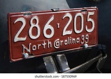 CONCORD, NC -- APRIL 05, 2014:  Closeup of a historic automobile license plate on display at the Charlotte AutoFair classic car show held at Charlotte Motor Speedway.