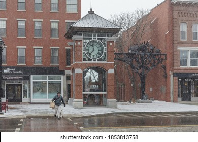 CONCORD, NH, USA - FEBRUARY 18, 2020: Clock on Main street. Street view of city in New Hampshire NH, USA.