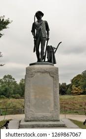 Concord, USA - October 6, 2018 - The Concord Minuteman statue near the Old North Bridge in Concord, Massachusetts