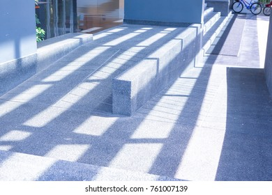 Concret ramp way with shadow and light for support wheelchair disabled people.