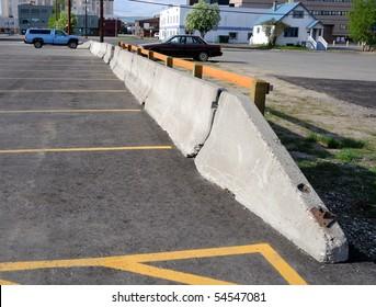 Concrete Barrier between parking lots