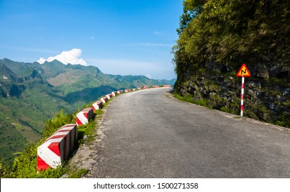 Concrete barriers at the hair pin curves at the Ha Giang loop road, north Vietnam. Road safety. Concrete guardrail.