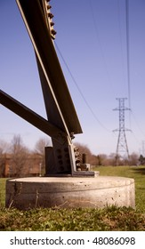 Concrete Base of Electricity Tower Bringing Power To Homes