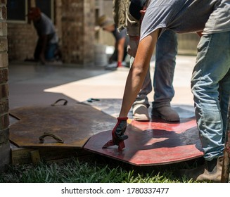 Concrete being stamped with pattern