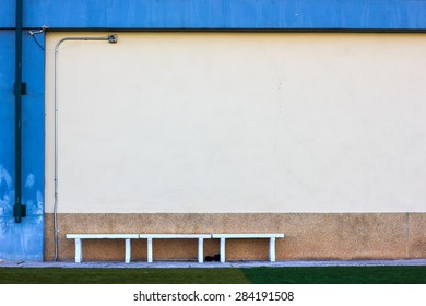 concrete bench in sport stadium and abstract grunge wall. Copyspace for your text. For presentation.