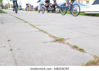 Concrete bicycle path with several bikes passing by