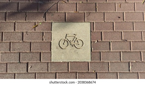 Concrete bike path sign in Israel
