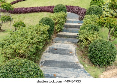 Concrete with black stone pathway in park