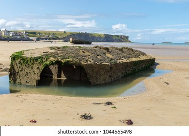 Concrete block close up, remains of Mulberry Artificial Harbor, Gold Beach World War II, Arromanches, Normandy, France with sea