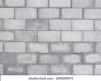 Concrete block wall texture. Grunge seamless wall background.