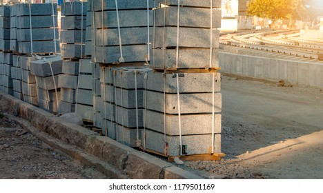 Concrete blocks on wooden pallets before using on the road