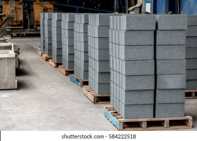 Concrete blocks on wooden pallets before loading