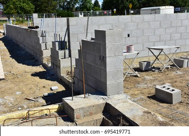 Concrete blocks and reinforcement rods in use to construct a commercial building.