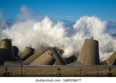 Concrete breakwater at the coast of Baltic sea, protection for the shore structure against high waves - Shutterstock ID 1689338677