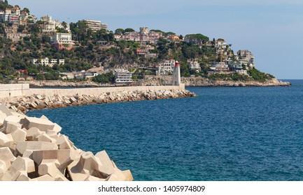Concrete breakwater with lighthouse in French Riviera. Entrance to the Port of Nice, France