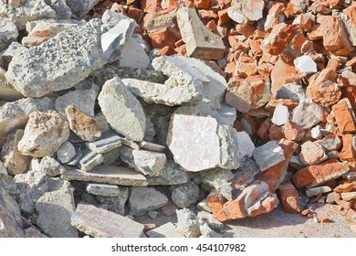 Concrete and brick rubble debris on construction site after a demolition of a building
