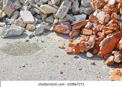 Concrete and brick rubble debris on construction site after a demolition of a brick building