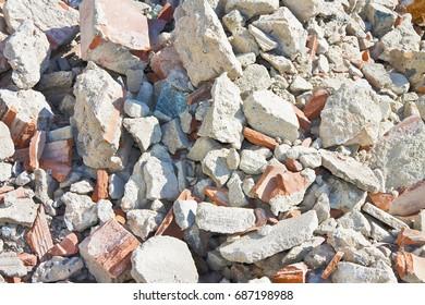Concrete and brick rubble debris on construction site after a demolition of a brick building
