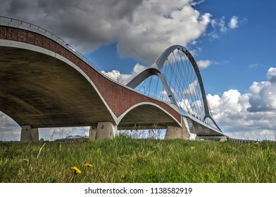 The concrete, brick and steel arches of new city bridge De Oversteek (The Crossing) across the river Waal near Nijmegen, the Netherlands