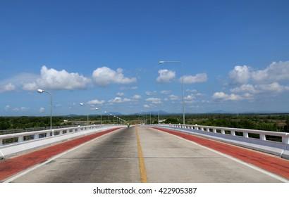 Concrete bridge with a car lane with a bike lane is clear.