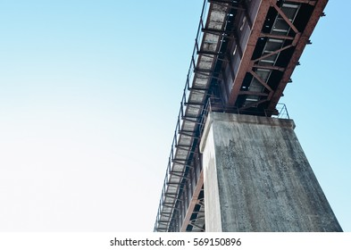 Concrete bridge support against a background of blue sky.