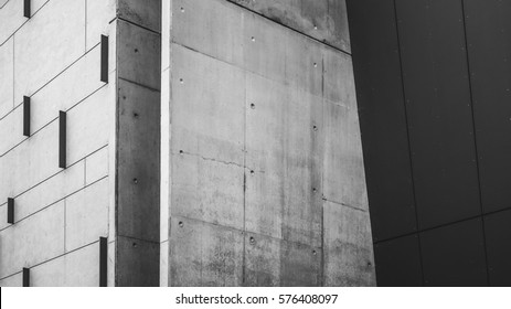 Concrete Building facade with lines and vertical features