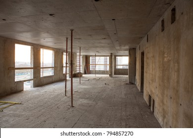 Concrete building, interior construction site. Reinforced concrete. Construction site. Residential building. Apartment renovation. Construction formwork, timber beams, plywood sheets