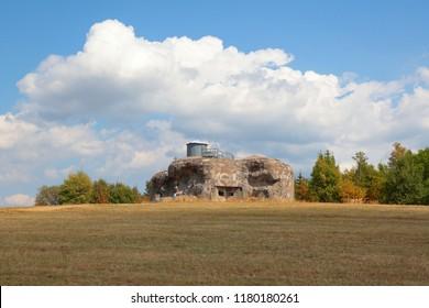 Concrete bunker from pre war era built in Czechoslovakia as a defense line on state borders. Dobrosov, Nachod, Czech republic. - Shutterstock ID 1180180261