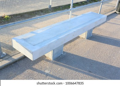 concrete cast cement seat or bench in a park area in harwich, uk