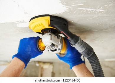 concrete ceiling surface grinding by angle grinder machine