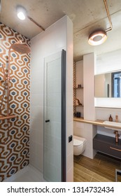 Concrete ceilings. Interior of a bathroom in a modern apartment.