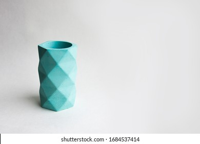Concrete cement pot. Hand made concrete planters for succulents and cacti. Empty cup isolated on white background. Polygonal geometric shape for home decor.