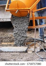 Concrete chute lowering into prepared casing